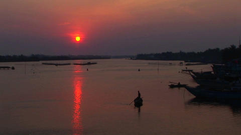 The sun sets behind the Mekong River in Vietnam Stock Video Footage