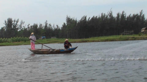 A Vietnamese fisherman casts his net into a river Stock Video Footage