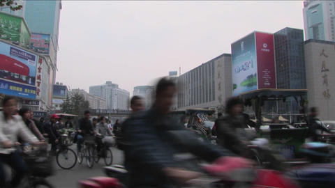 Traffic moves along a busy boulevard in Beijing China Stock Video Footage