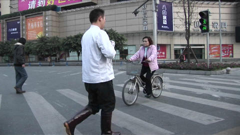 A traveling shot follows people crossing the street on a... Stock Video Footage