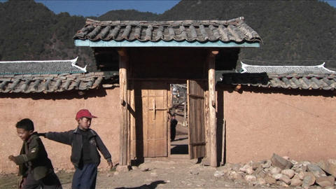 Kids leave a small school in rural China Stock Video Footage