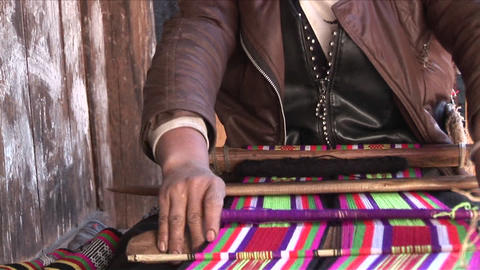 An old woman works her loom in rural China Stock Video Footage
