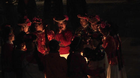 Ethnic Chinese gather around a fire at night for a ceremony Stock Video Footage