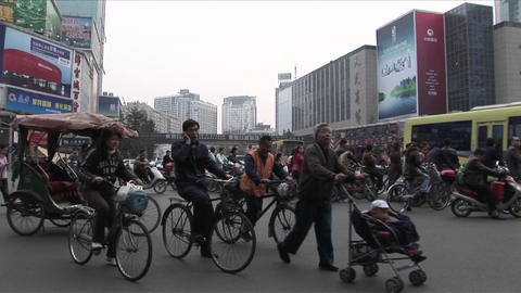 Crowds of people and bicycles circulate on the streets of Beijing, China Footage