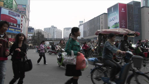 Crowds of people and bicycles circulate on the streets of... Stock Video Footage