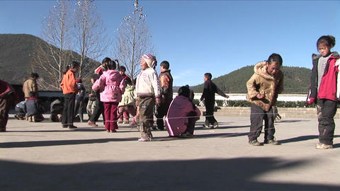 Chinese children play games in a schoolyard Stock Video Footage