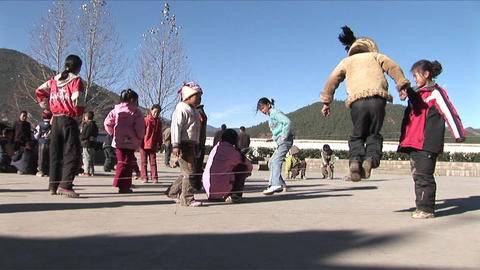 Chinese children play games in a schoolyard Footage
