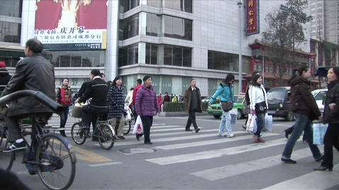 Rickshaws and pedestrians crowd the streets of Beijing,... Stock Video Footage