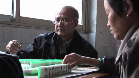 Chinese citizens play Mah Jong to pass the time Stock Video Footage