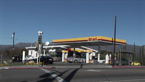 A time lapse shot of a gas station as traffic moves... Stock Video Footage