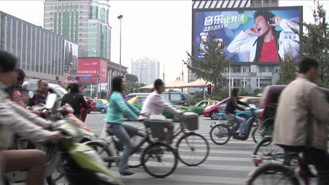 Large amounts of traffic pass by on a Beijing China... Stock Video Footage