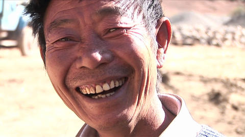 A happy Asian man smiles at the camera Stock Video Footage