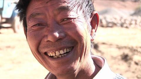 A happy Asian man smiles at the camera Footage