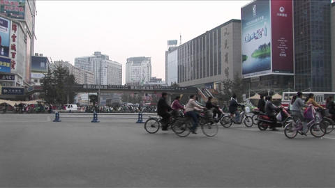 Motorcycles crowd a street in Beijing, China Footage
