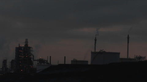 A time lapse shot from night to day of a petrochemical factory or oil refinery Footage