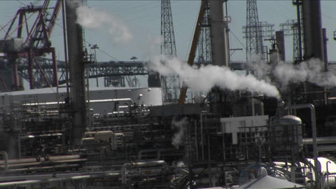 Steam rises from an industrial area Stock Video Footage
