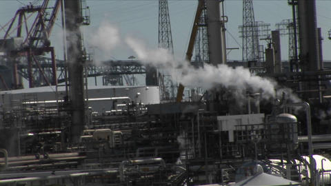 Steam rises from an industrial area Footage