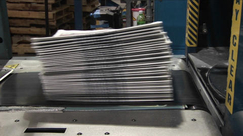 An assembly line with newspapers Stock Video Footage