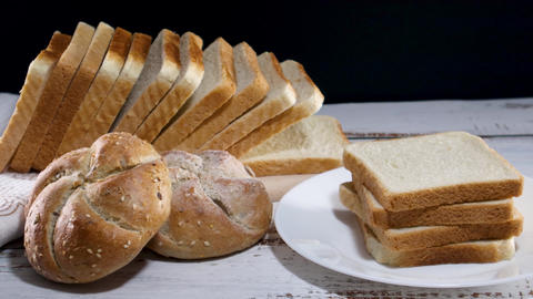 Close up of fresh bakery products, fresh toast bread and two buns with sesame. healthy lifestyle Live Action