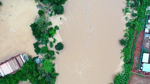 Drone footage of an overflowing river causing flood Live Action