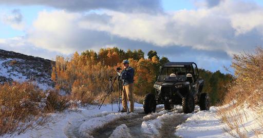 Photographer mountain winter road autumn colors DCI 4K 526 Footage