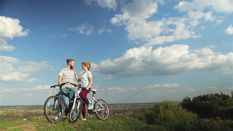Man and woman with bicycles Footage