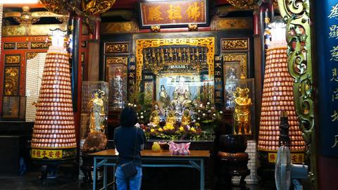 Woman praying inside Hsinchu Cheng Huang temple Live Action