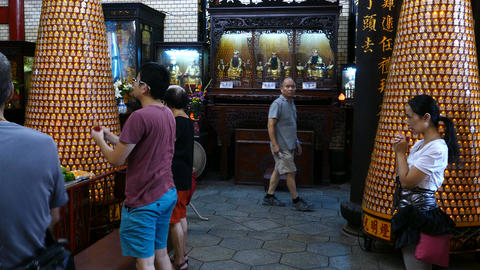 People praying inside Hsinchu Cheng Huang temple Footage
