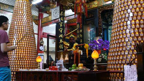 Boy praying inside Hsinchu Cheng Huang temple Live Action
