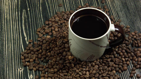 Coffee cup and coffee beans on table Footage