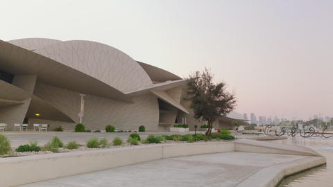 National museum of Qatar in Doha Qatar exterior daylight panning shot Live Action