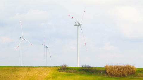 wind energy turbines are one of the cleanest, renewable electric energy source, under blue sky with Live Action
