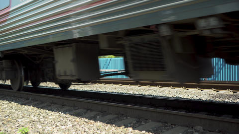 Passenger train is passing by. Side view of the wheels. Rail transport to Live Action