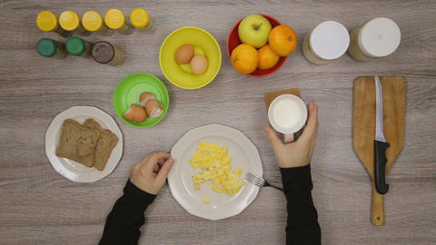 Man eat eggs in kitchen Footage