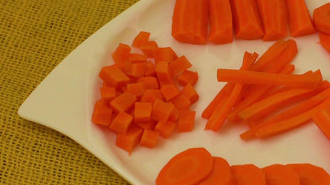 Chopped and sliced carrot on white plate Footage