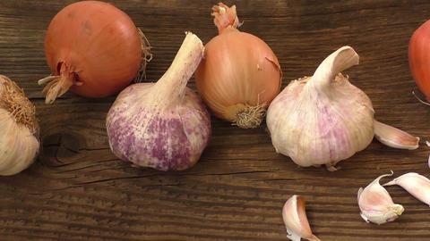 Garlic and onion on cutting board Footage