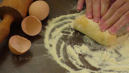 Baker hands kneading dough in flour on table Footage