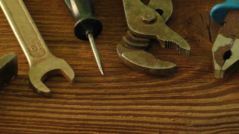 Set of old tools to repair on a wooden surface: hammer, pliers, wrench, screwdri Footage