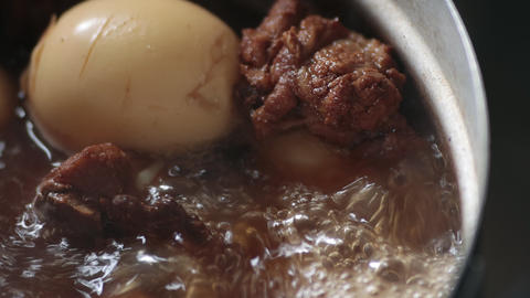 Thai Food Pork and Boiled Eggs in Sweet Brown Sauce or Thai Stewed on Left Frame Live Action