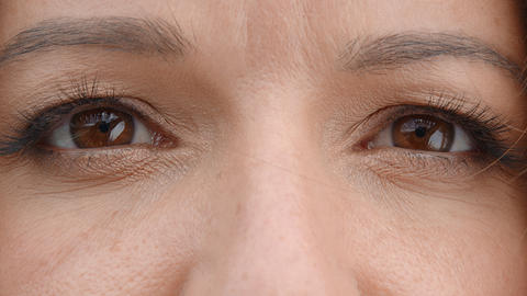 Brown woman eyes close up. Women's eyes are brown, slowly closing and opening Live Action