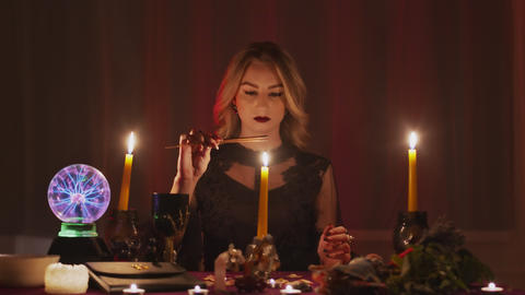 A fortuneteller in a magic salon lights magic incense for paranormal ritual Live Action