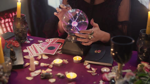 Close up of fortune teller performing ritual and crystal ball foreseeing future Live Action