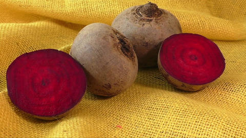 Fresh beetroot isolated on yellow background. Healthy food Live Action