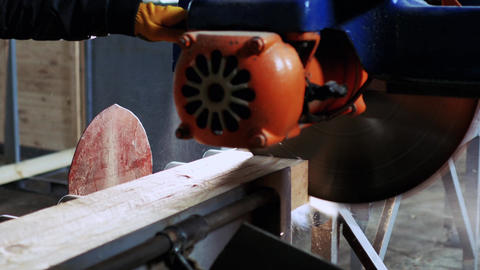The man moves a large saw to cut a few bars Footage