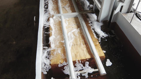 Lumber industry - Soaking the block with wood GIF