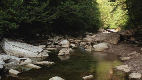 mountain river among large stones. Mountain river and rocks Live Action