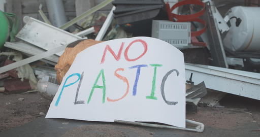 No plastic poster lying on garbage outdoors. Human impact on environment Live Action