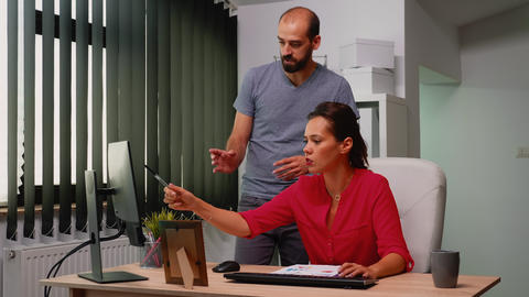 Woman pointing on desktop Live Action