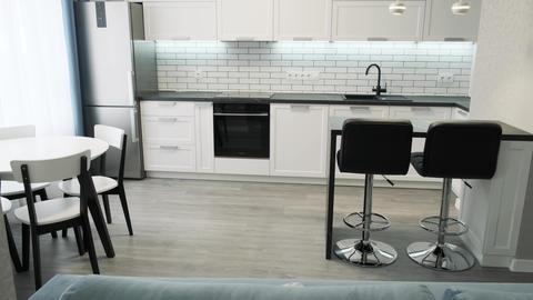 Dolly shot of scandinavian design minimalist kitchen interior. Light interior of Live Action