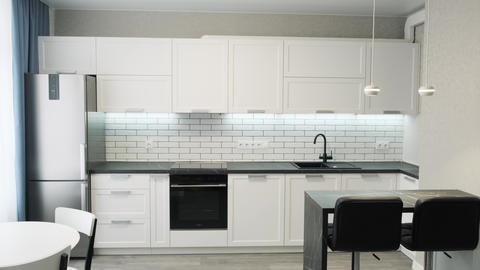 Simple well designed modern white wooden kitchen interior. Light interior of a Live Action
